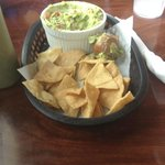 Guacamole and chips -- see the avocado pit?