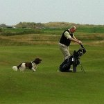 Golfer with his dog.