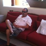 My husband relaxing in lobby....(where I would come for FREE Internet reception)