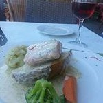 Salmon poached in white wine with lemon and dill sauce - delicious!