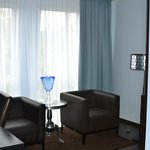Sitting area w/desk, closet and safe