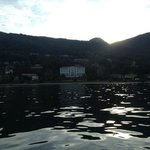 view of Lido Palace Hotel from boat on Lake Maggiore.