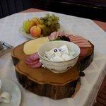 Lovely fruit and meat/cheese tray.  I love the wood serving block.  Classy breakfast service.