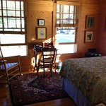 quaint ,rustuc room with private entry door and a wraparound porch that overlooks the river,