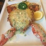 Wood oven roasted Maine lobster stuffed with Yukon gold potatoes and topped with chive butter sa