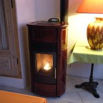 The ceramic, pellet burning stove in the dining area