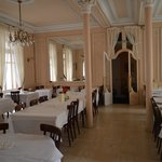 Other view of dining room. Note the huge mirrors at the end.
