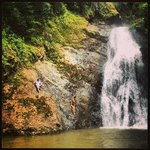 cliff jumping off bottom waterfall