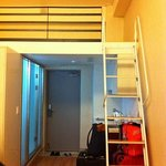 The loft is accessible via a steep ladder