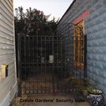 Security gate to courtyard/access to cottages