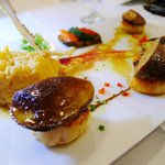 Scallop topped with fried foie gras