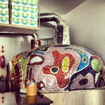 Our hand-laid mosaic pizza ovens