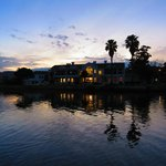 Hotel from lake side by Sunset