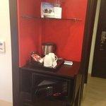 complimentary tea coffee a digital safe and a fridge