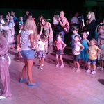 Mini disco - kids dance as girls from Mini club lead