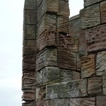 The ancient walls have been scoured by the sea winds