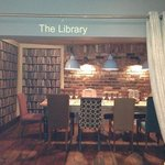 the lovely library area. quirky wallpaper and amazing chairs. :)