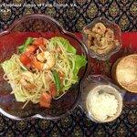 SomTumKaPi -A traditional Thai savory papaya salad with sticky rice and rinds.