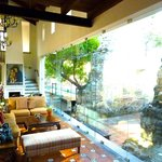 Sitting room with huge glass window, wall, door... to outside