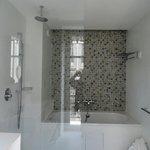 Huge bathroom with balcony.  Massive tub.
