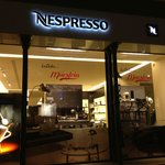 Next door.  Go for a sample cup of expresso.