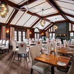 """The main floor dining room is decorated as a grand European hunting lodge"" TA Review"