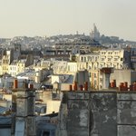 View over Paris from the roof of the hotel. Sacre Cœur in the background.