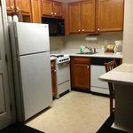 Almost a full kitchen; full fridge, stove w/ oven and 4 eyes