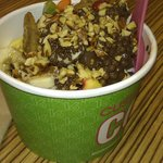 Cup filled with yogurt with toppings