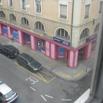 Pinky store and a person wandering around