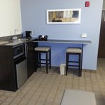 Queen Suite. Mini bar area with mini fridge, microwave, and coffee maker.