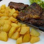 Veal with side dish fried potato was delicious..