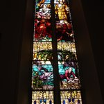 """The Resurrection .../ Jonah..."" stained glass window"