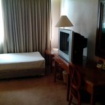 Room with extra bed and large conventional TV
