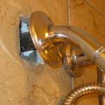 Exposed plumbing behind shower