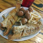 Bone-in catfish and fillets with homemade coleslaw and hushpuppies