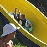 His first big waterslide and backwards