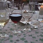 A glass of different wine with each of the 4 courses.
