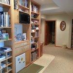 Bookshelves and refrigerator. Bathroom on left.