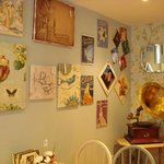 Music sheets and pictures on the walls with Gramophone in the corner