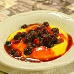 Delicious crema catalana with red fruits