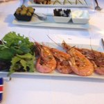 Small portion of grilled prawns on tapas menu