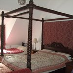 One of the two four-poster beds