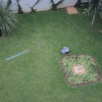 Robot mower on the grounds below the room
