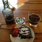 Decadent lunch - warm brownie and a cold Coca beer made locally by Lucho.