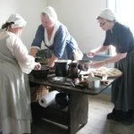 A Hearth-Cooking Class Preparing a Meal