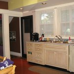 The kitchen is clean and well-equipped for cooking