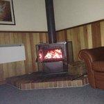 Lounge Room, generous supply of wood at front door.