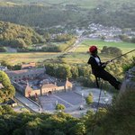 Abseiling with Llanberis in the background.