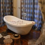 Bubble bath tub with rose petals